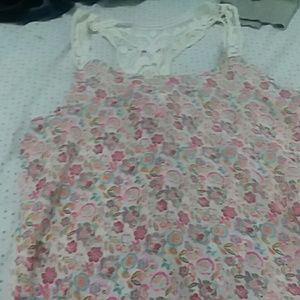 A pink tank top is size Large 11-13